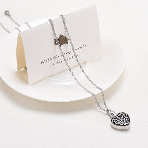 Heart Pendant For Ashes Draped Over Card and Plate