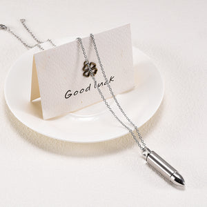 Bullet Cremation Jewelry - Pendant Draped Over Plate