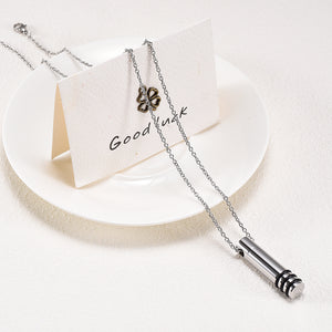 Cylinder Necklace Draped Over Card and Plate