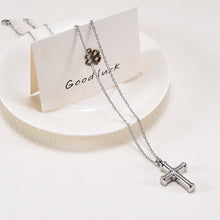 Load image into Gallery viewer, Cross Cremation Jewelry - Necklace Draped Over Plate