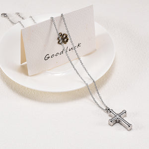 Cross Cremation Jewelry - Necklace Draped Over Plate