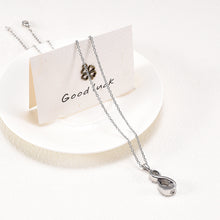 Load image into Gallery viewer, Infinity Pendant For Ashes Draped Over Card and Plate