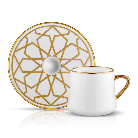 White coffee cup and saucer with gold details