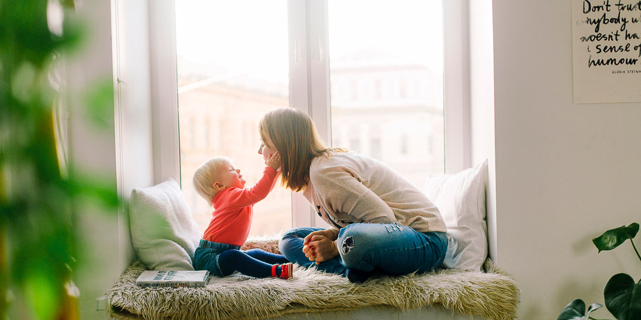 mother happy with child because she takes american ginseng which helps reduce stress and increase energy
