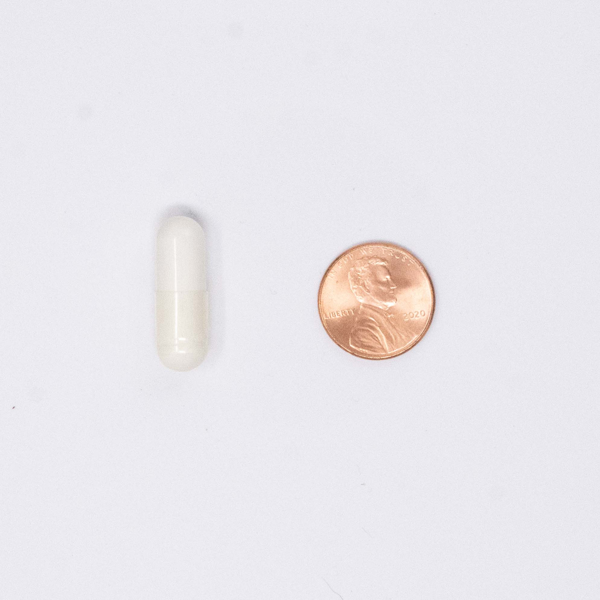 bone support vitamin next to a penny