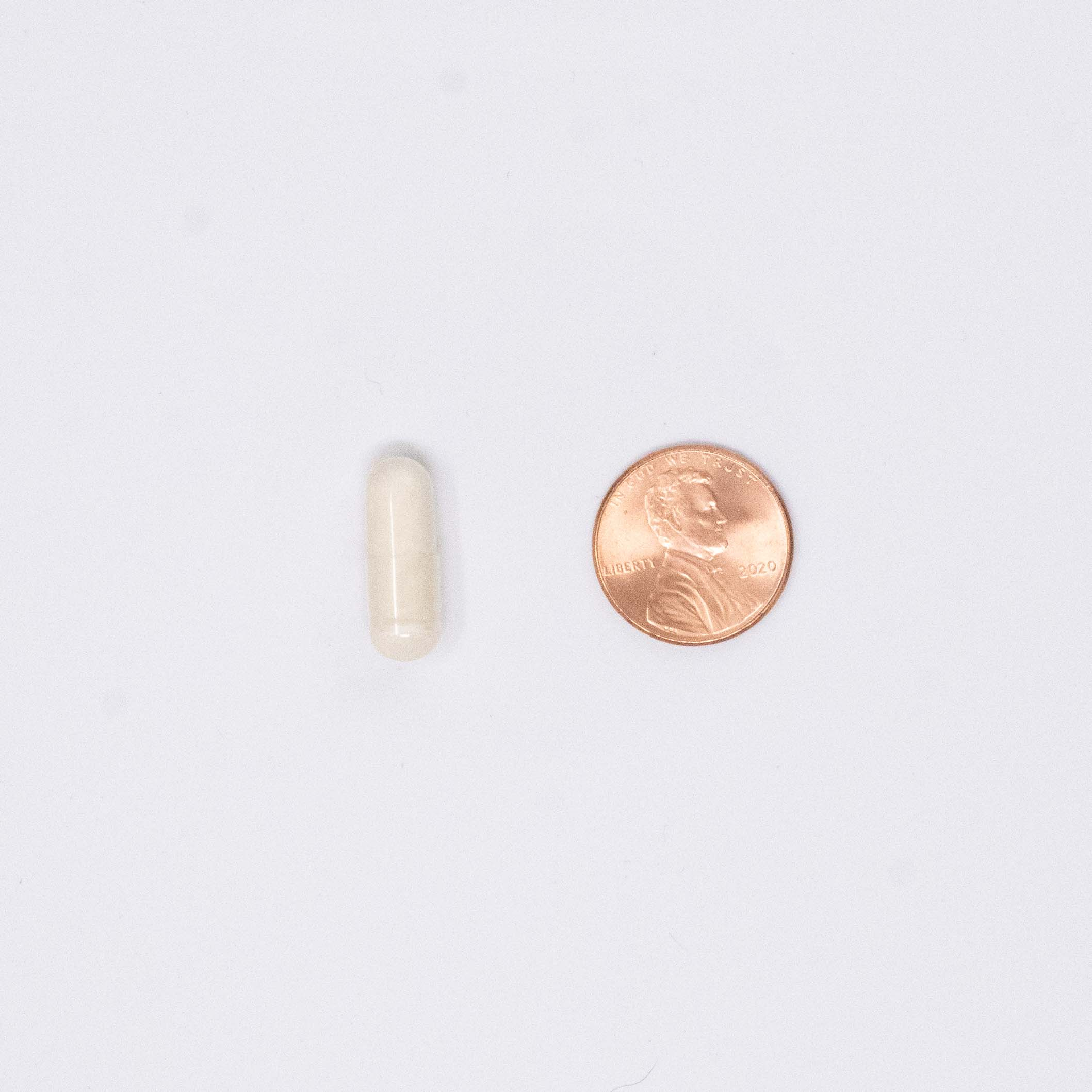 Vitamin D pill compared size to a penny