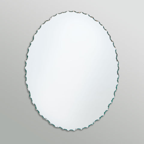 Better Bevel Frameless Chiseled Edge Oval Mirror on grey wall