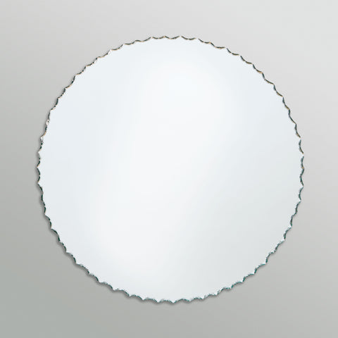 Better Bevel Frameless Chiseled Edge Round Mirror on grey wall