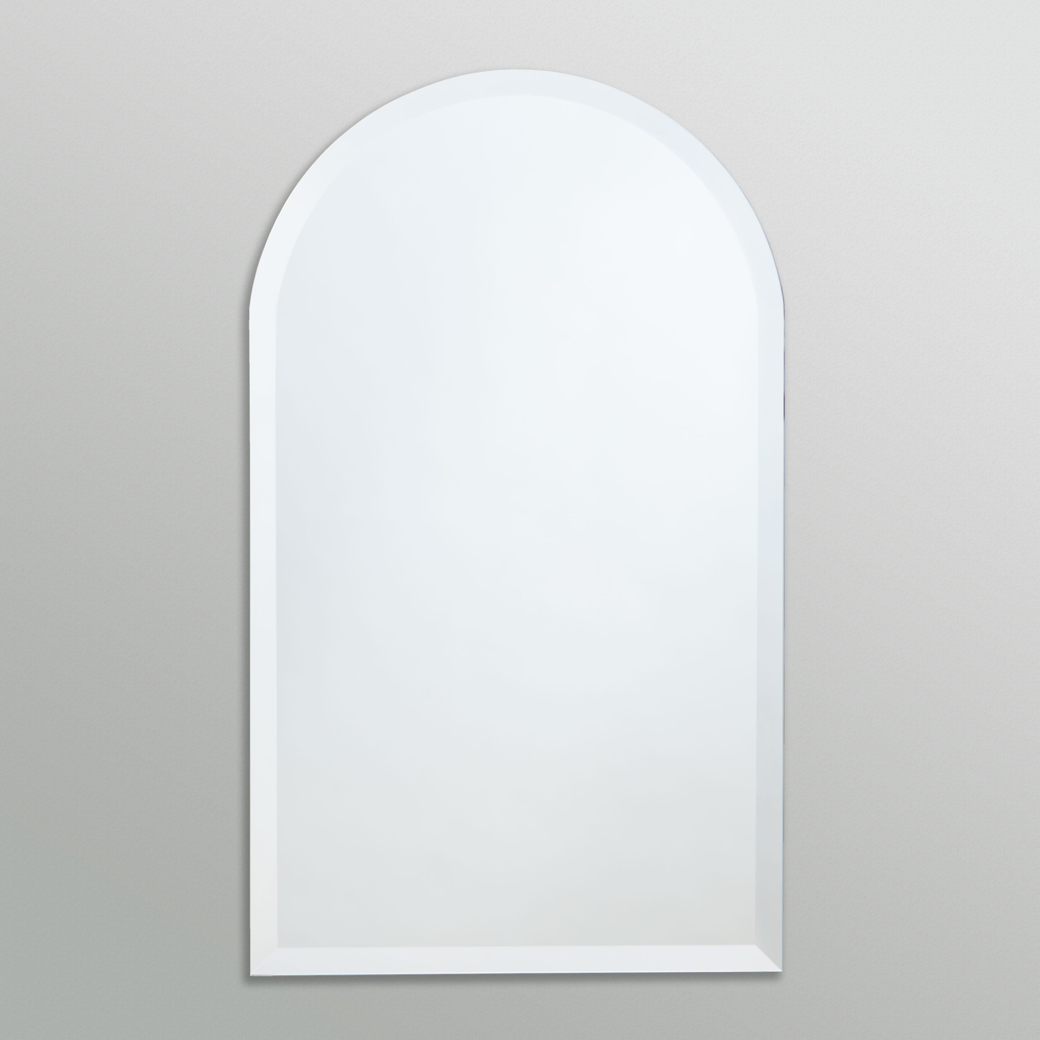 Better Bevel Frameless Beveled Arch-Top Rounded Mirror on grey wall
