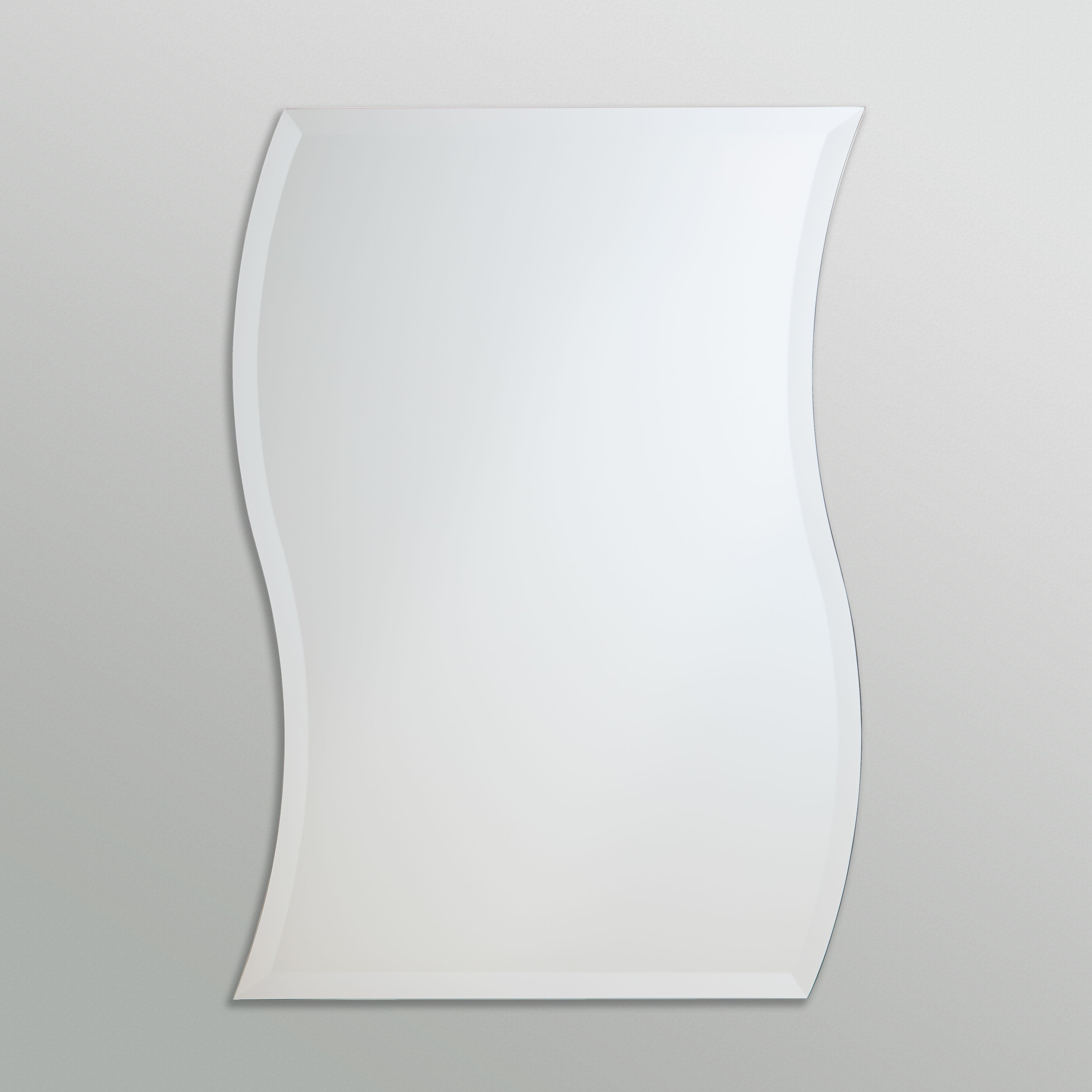 Better Bevel Frameless Beveled Swerve Wavy Mirror on grey wall
