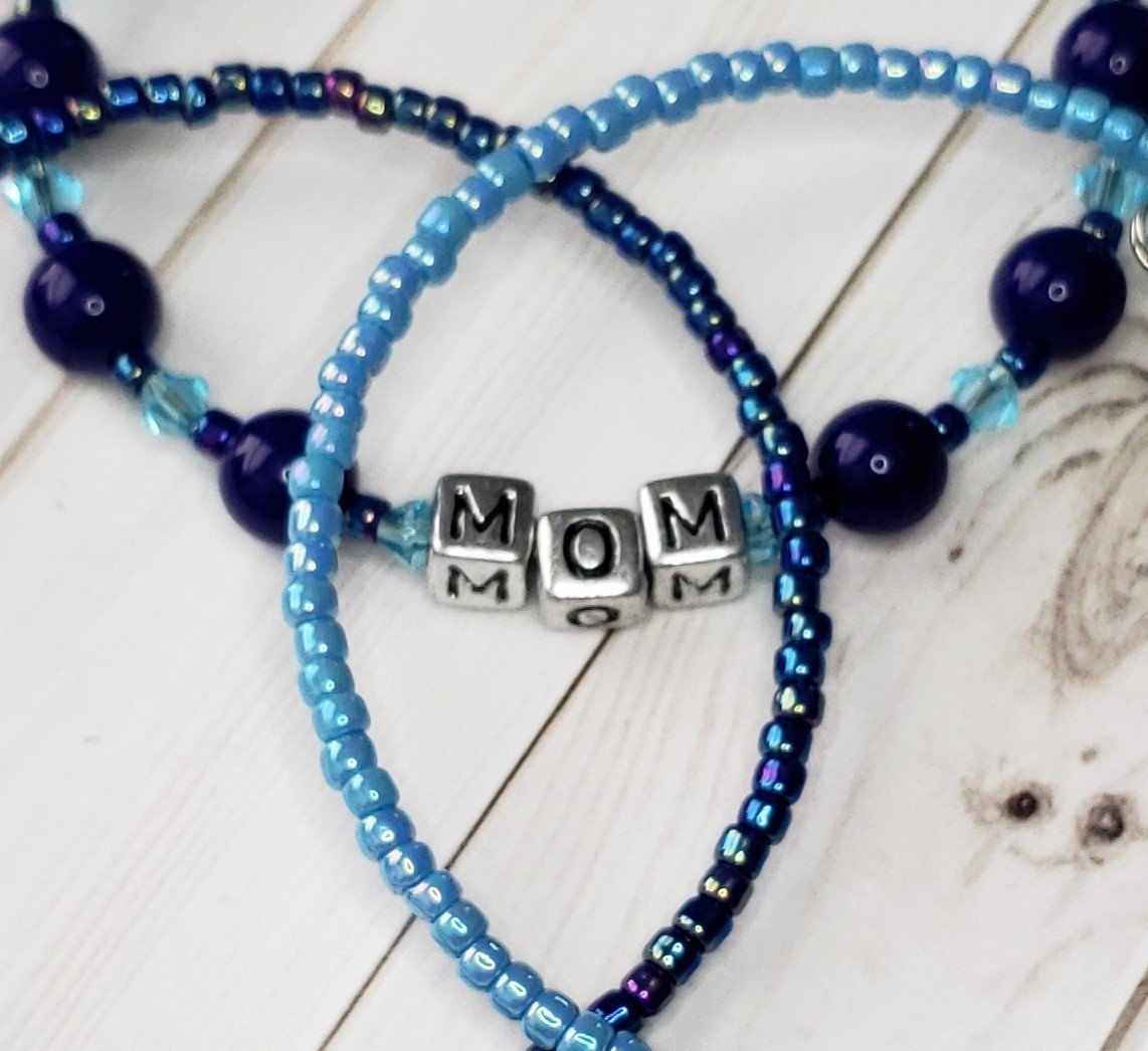 Cobalt Druk MOM memory wire bracelet with two coordinating seed bead bracelets