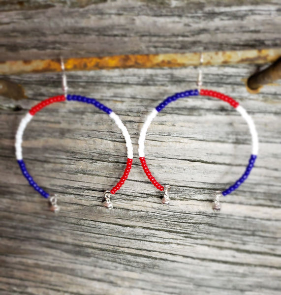 Southwestern Red, White, and Blue crescent earrings with sleigh harness bells