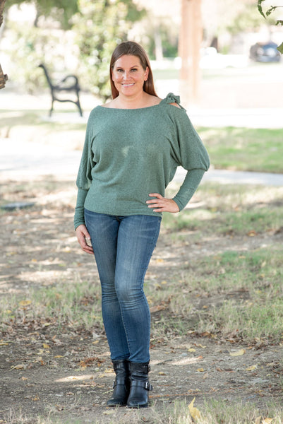ribbed tie shoulder top or sweater that can worn multiple ways. color is mint green.