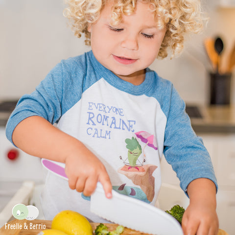 Young boy chopping broccoli with a nylon knife