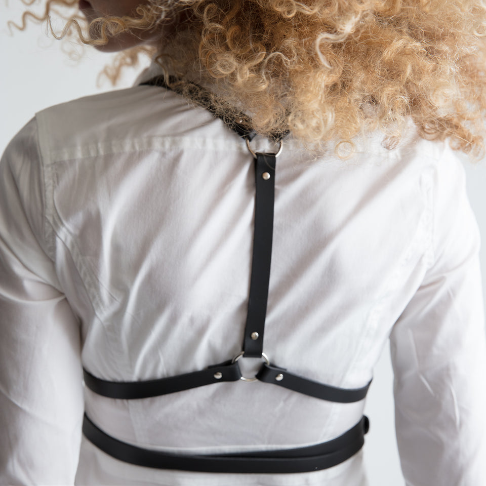 model wearing classy woman body harness