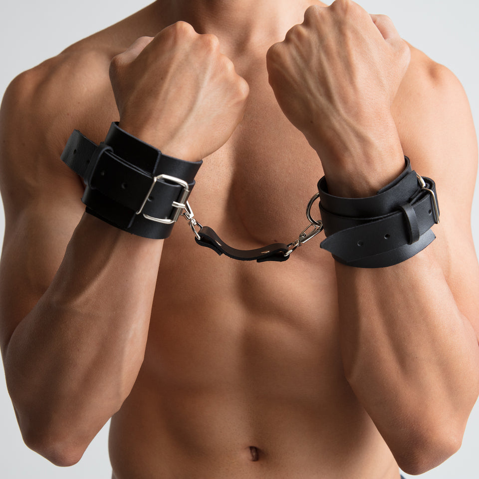 model wearing handcuffs mens bracelet