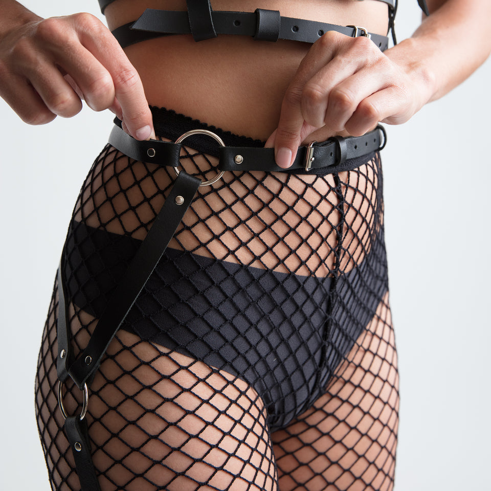 model wearing new york garter belt