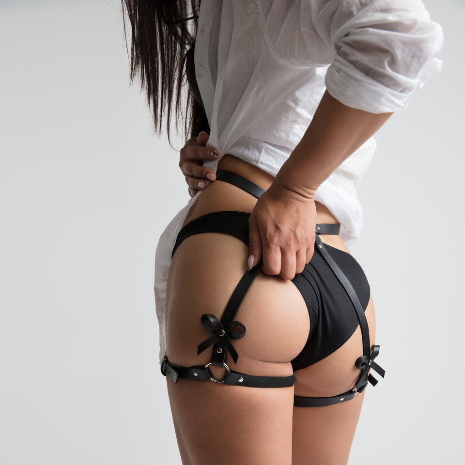 model wearing garter belt bow shorts