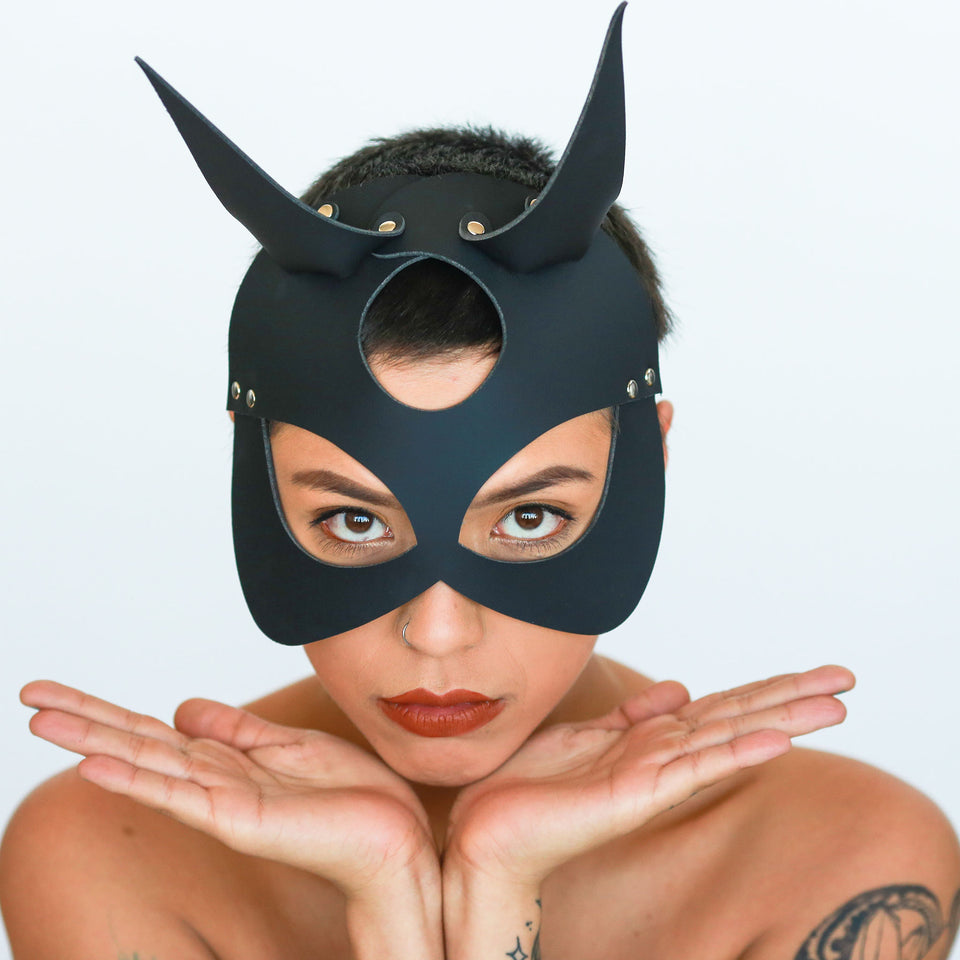 model wearing devil mask