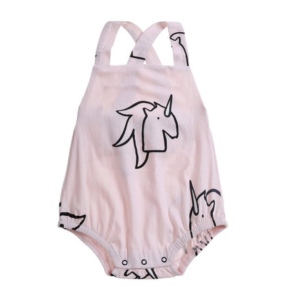 Anarkid pink romper with unicorn print in black with frills on the rear and cross over straps for baby