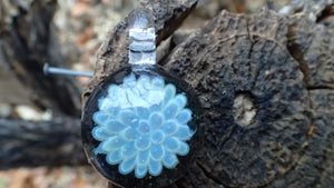 Small Flower Boom Pendant that is Light blue and white