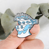 Statue head Enamel pin