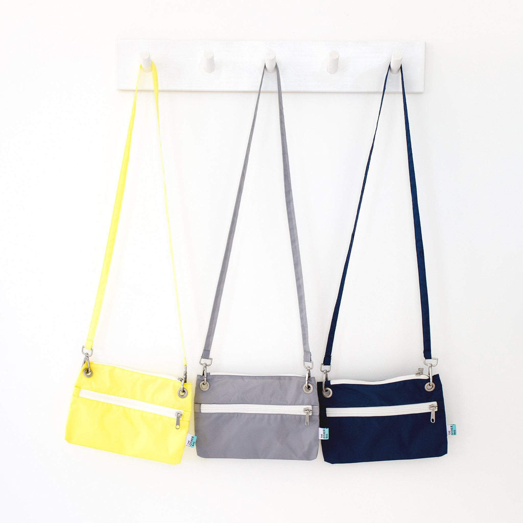 Recycled zip pouches hanging various colours