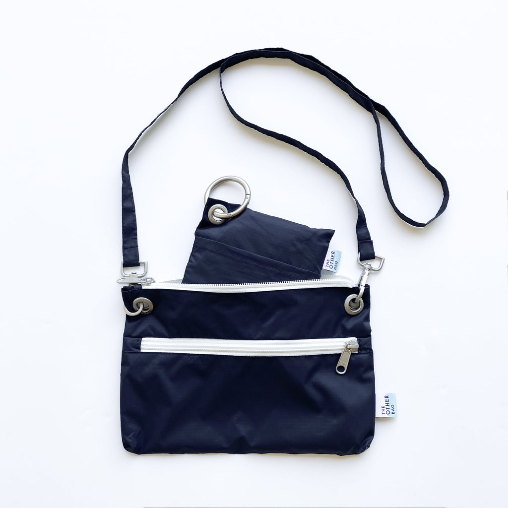 Navy Econyl crossbody bag and foldable tote bundle