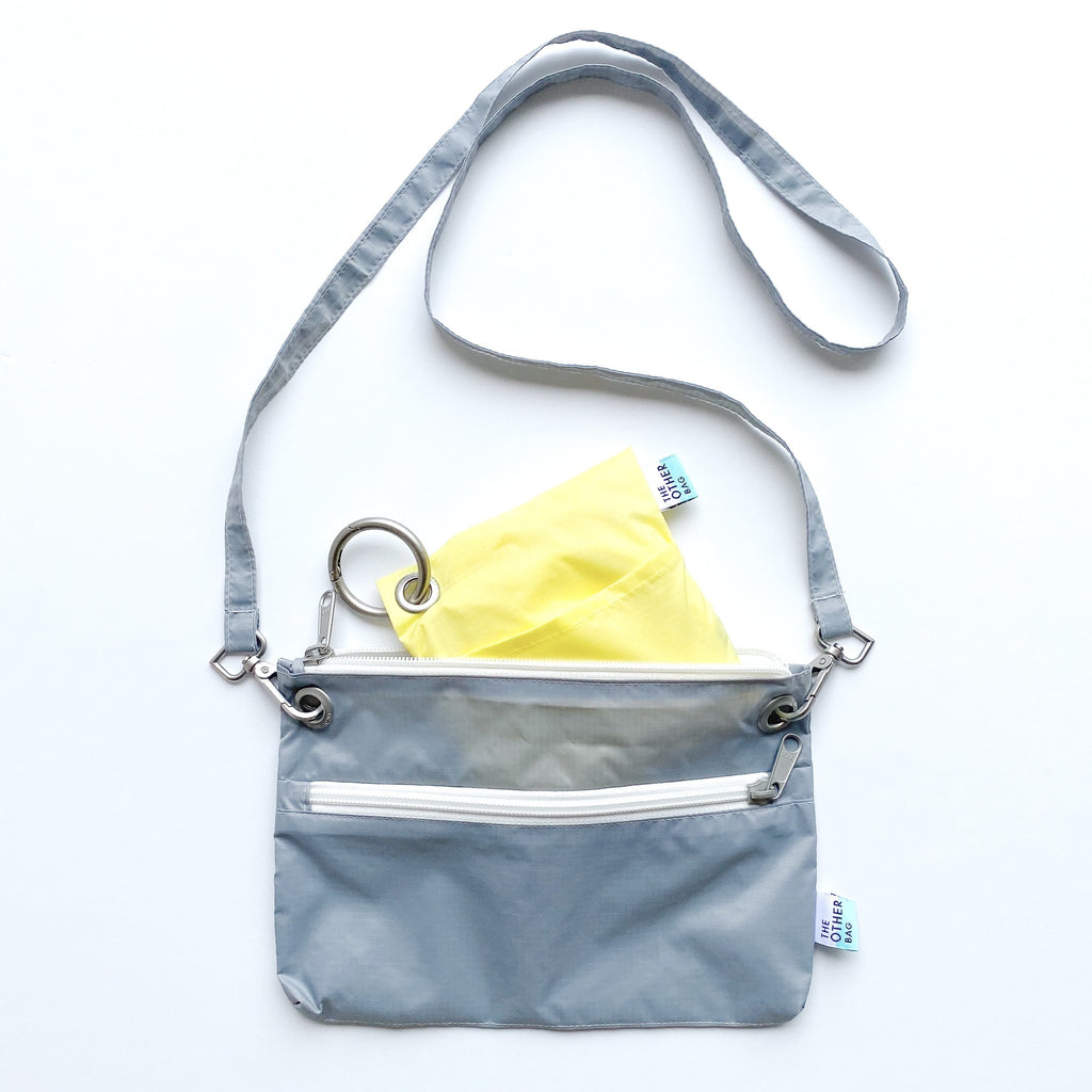 Econyl crossbody bag and econyl foldable tote bundle grey and yellow