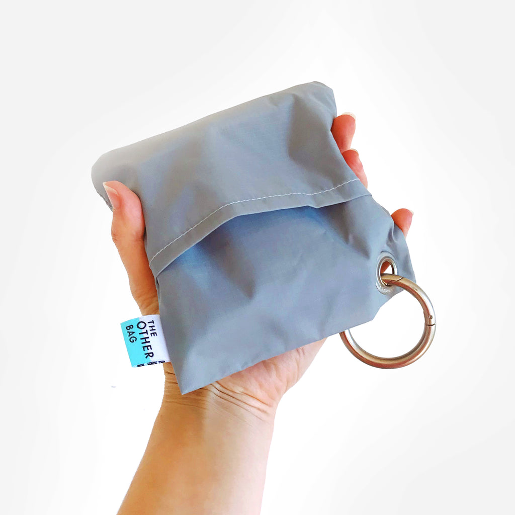 Econyl grey and aqua reusable shopping bag in pouch with ring