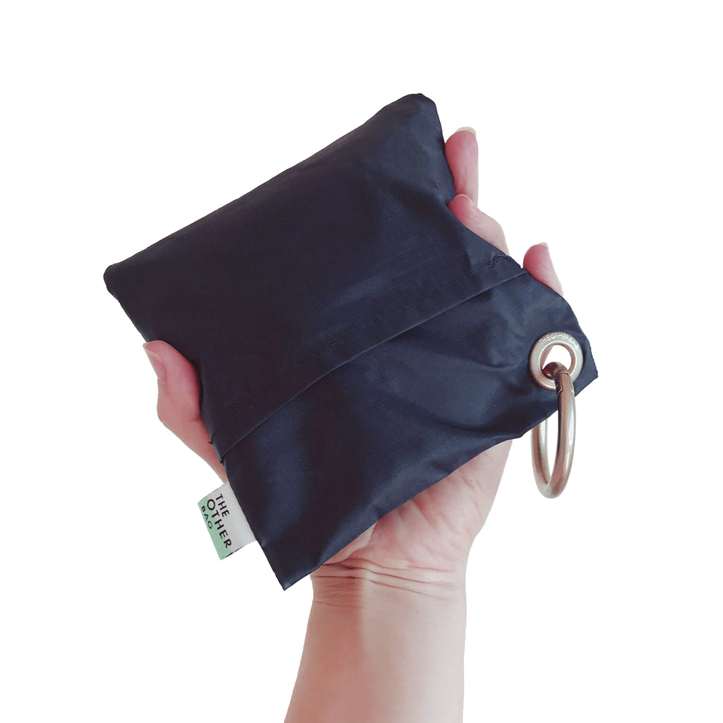 Econyl navy blue foldable sustainable tote bag in pouch