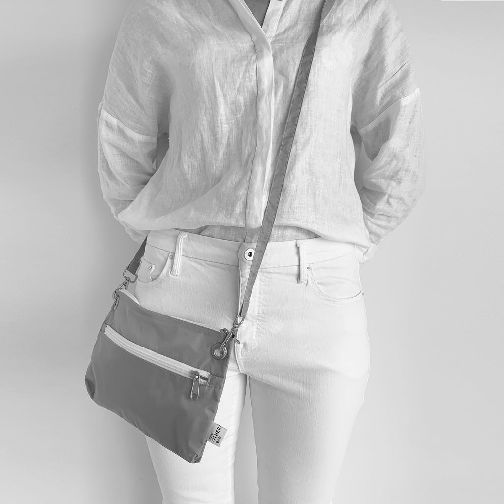 recycled crossbody bag shown worn on body