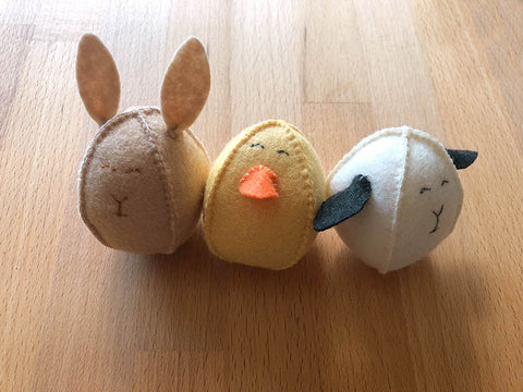 3 felt easter eggs in the shape of a bunny, chick and lamb