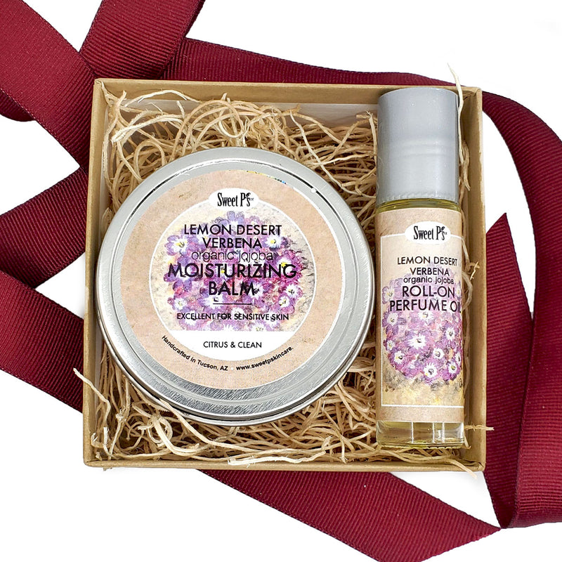Gift set with organic lemon desert verbena moisturizing balm and jojoba based perfume oil. Both are made with organics. Comes in craft box with burgundy ribbon.