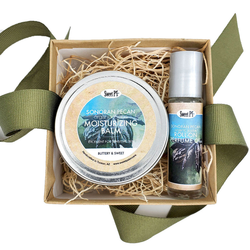 Organic jojoba oil roll on perfume with organic jojoba and shea butter moisturizing balm in a cute gift box