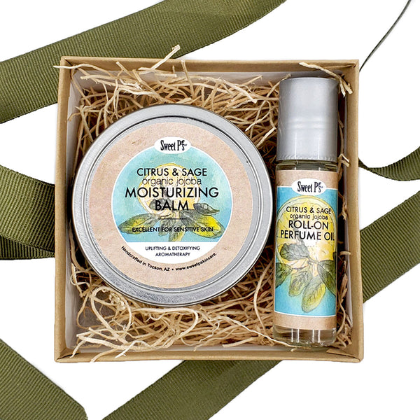 Citrus and sage gift set. This set contains a moisturizing balm and a roll on perfume oil. Both are made with certified organic jojoba oil and are cruelty free.