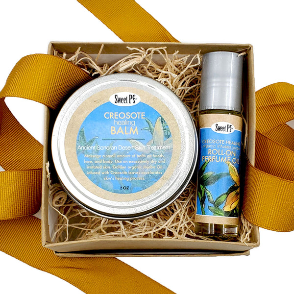 Small, 2 piece gifts set contains creosote healing balm and creosote roll-on perfume. Both are infused with creosote leaves that were wild harvested from the sonoran desert in tucson, arizona