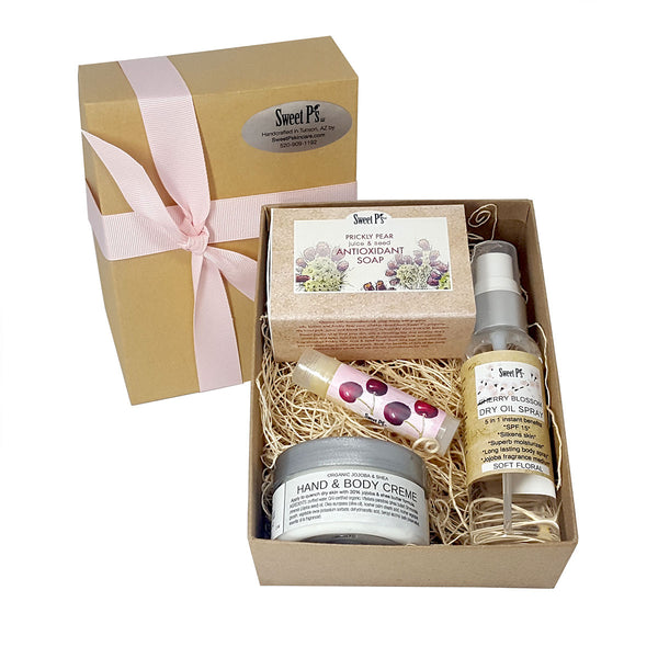organic skincare gift set comes with prickly pear soap, cherry blossom dry oil spray and lip balm, and fragrance free hand and body creme