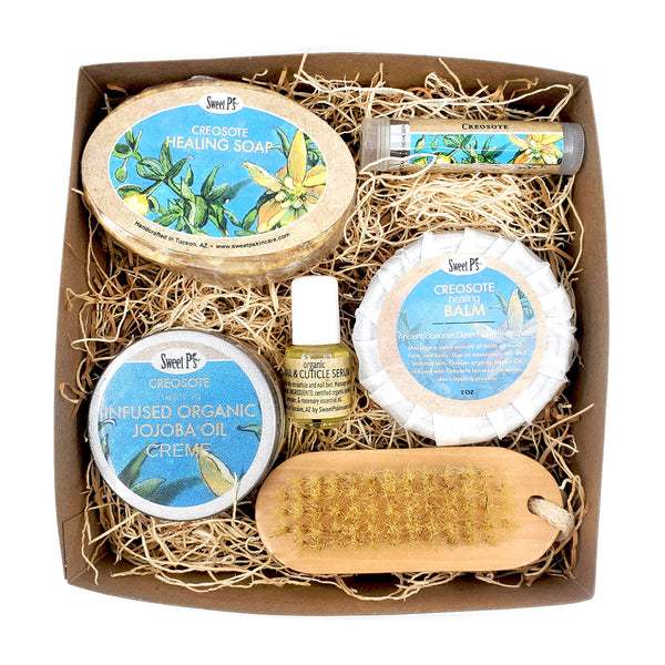 healing creosote skin care set contains soap, hand cream, balm, cuticle serum, nail brush and a creosote lip balm.