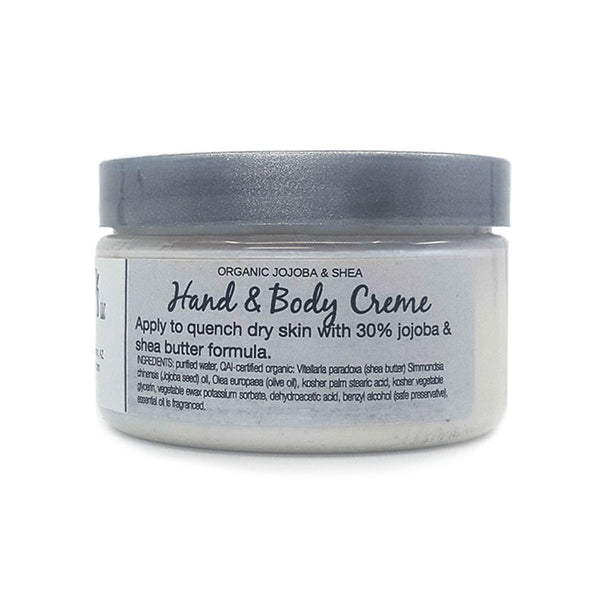 Fragrance free hand and body cream instantly moisturizes dry skin. Made with organic jojoba oil and shea butter.