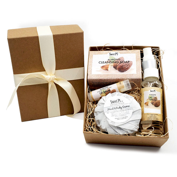 almond scented organic skincare set includes: soap, lip balm, dry oil spray and hand and body cream. cruelty free