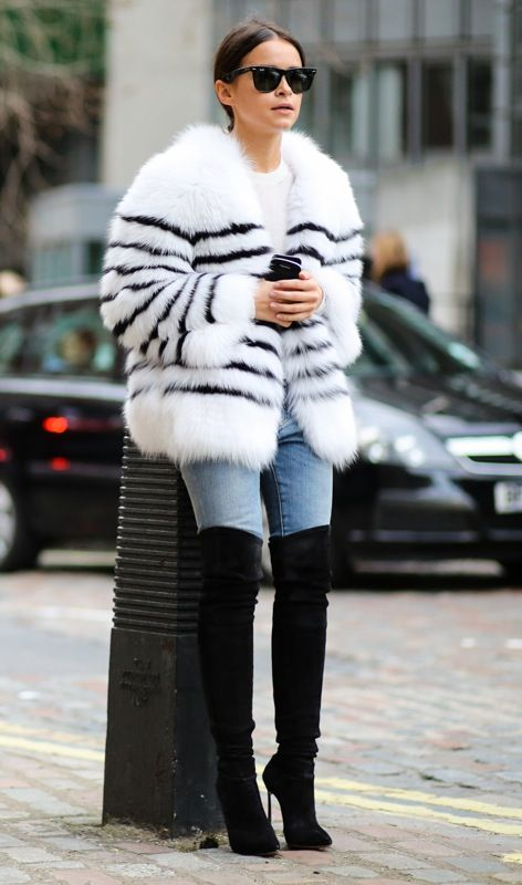 faux fur and long boots with jeans