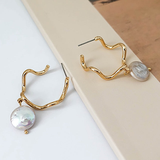 Avril Curved Faux Pearl Hoop Earrings In Gold - Mad Jade