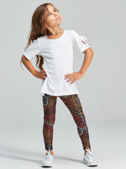 Black kid's leggings featuring a Dreamtime inspired Aboriginal dot design