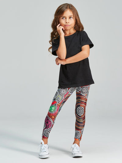 Bold and vibrant coloured kid's leggings with an overall Indigenous design