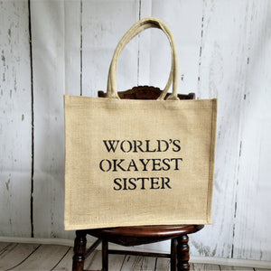 World's Okayest SisterBurlap Tote Bag