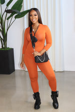 "The ""Keep Me Fly"" Rust Jumpsuit"