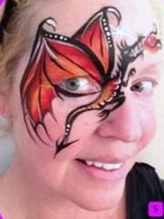 Laura Oliver Dragon Face Paint design fusion body art