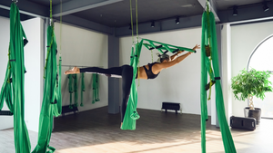 Trim off that Christmas Fudge with Aerial Yoga