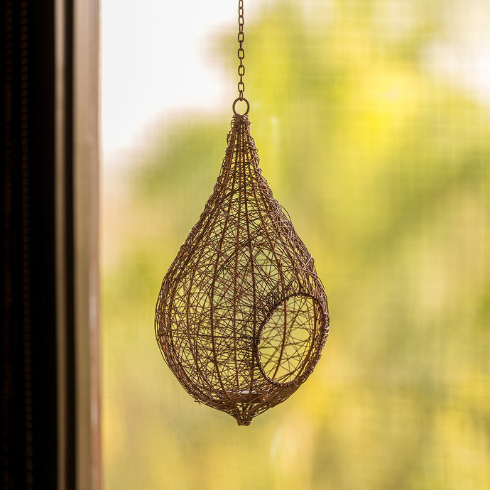 'Weaver Bird Mesh House' Handwoven Hanging Tea-Light Holder In Iron (15 Inch, Copper Finish)